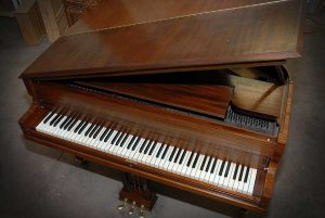 restored antique piano