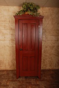 red wood cabinet milk paint